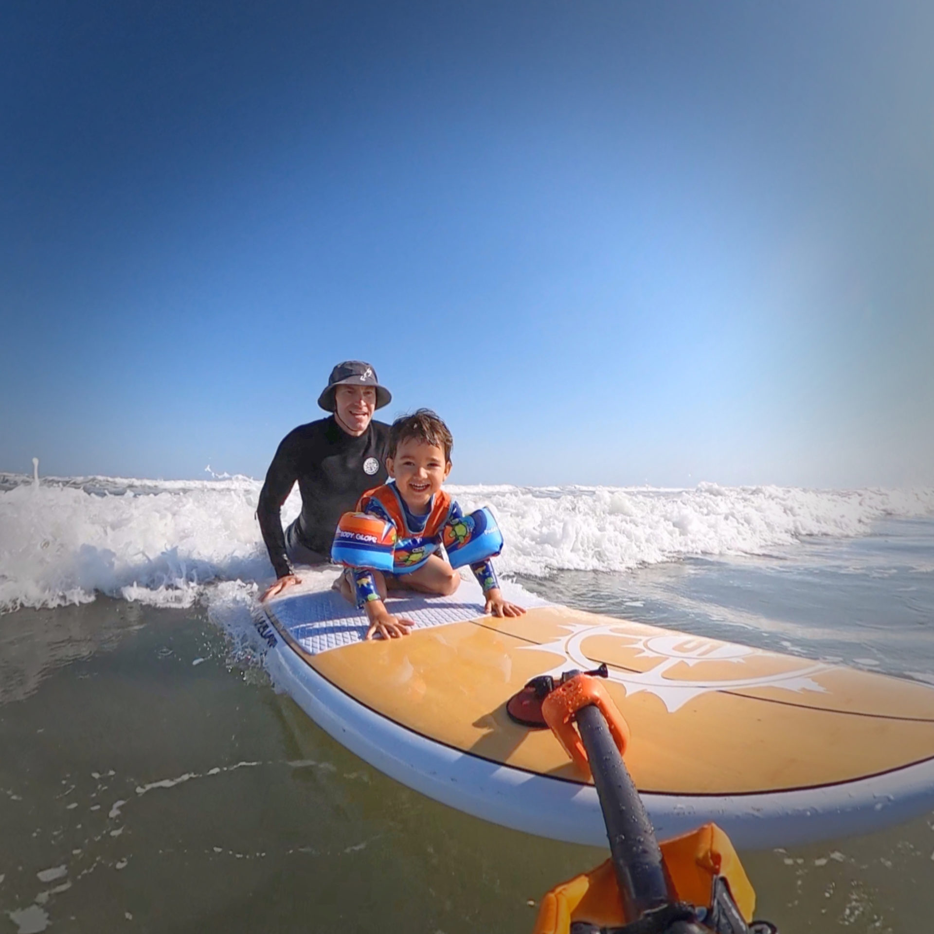 Rohan surfing with son